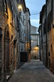 Petriolo medieval village in Marche Region, central Italy. Typical alley in the medieval historic center of the village of Petriolo. Marche region, central Italy stock photo