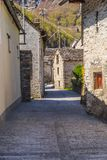 Typical alley among traditional stone houses. In Sonogno in Locarno district, Switzerland Royalty Free Stock Photography