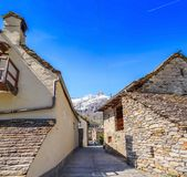Typical alley among traditional stone houses. In Sonogno in Locarno district, Switzerland, vertical panorama shot Stock Photography