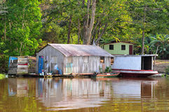Typical Amazon Jungle Home (Amazonia). The typical floating house Amazon Home architecture, in a shot on the rainforest. Ribeirinhos is the name of the people Royalty Free Stock Photography
