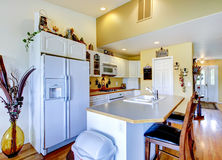 Typical American Kitchen interior with white appliances and isla. Kitchen interior with white appliances, and hardwood floor Royalty Free Stock Image