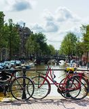 Typical Amsterdam bike view. One of the cannals in the centre of Amsterdam Royalty Free Stock Photo