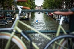 Typical Amsterdam bike view. One of the cannals in the centre of Amsterdam stock image