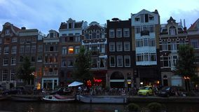 Typical Amsterdam buildings in the evening  City of Amsterdam stock video