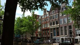 Typical Amsterdam buildings at Leidsegracht on a sunny day City of Amsterdam. Typical Amsterdam buildings at Leidsegracht on a sunny day Amsterdam Netherlands stock video footage