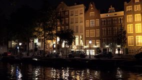 Typical Amsterdam buildings by night  City of Amsterdam. Typical Amsterdam buildings by night  Amsterdam Netherlands videoclip stock footage
