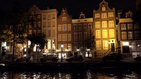 Typical Amsterdam buildings by night  City of Amsterdam. Typical Amsterdam buildings by night  Amsterdam Netherlands videoclip videoclip stock footage
