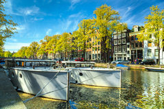 Typical Amsterdam canals with boats and harbors, Netherlands, Europe stock images