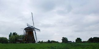 A typical Amsterdam mill royalty free stock images