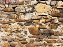 Typical ancient Italian house wall made of stones royalty free stock photo