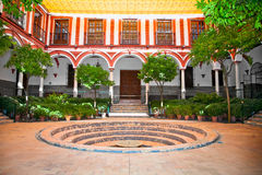 Typical andalusian courtyard with fountain, Seville, Spain. Royalty Free Stock Photo