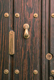 Typical andalusian door with  knocker and mailbox Royalty Free Stock Images