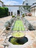 Typical Andalusian patio. Typical Andalusian patio with fountain and numerous plants. Cordoba, Spain Stock Photos