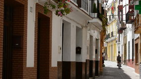 Typical andalusian street. People walking in a typical andalusian street stock video