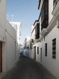 Typical Andalusian street with whitewashed houses Stock Photography