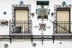 Typical andalusian white village house window and flower decoracion royalty free stock photos