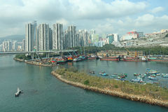 Typical apartment blocks in residencial area of Hong Kong and harbour with boats Stock Images