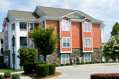 Typical apartment building in suburban area. With landscaped grounds Stock Images
