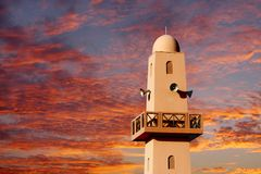A typical Arabic mosque minaret with loud speaker on sunset Royalty Free Stock Photo