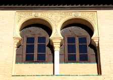 Typical arabic windows of Real Alcazar, Seville. Windows with decoration in the arabic style in the Real Alcazar in the Spanish city of Seville. The construction Royalty Free Stock Images