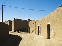 Typical architecture in Merzouga. Streetscape in Merzouga -Morocco with its typical buildings out of loam next to the desert Erg Chubby Royalty Free Stock Photo