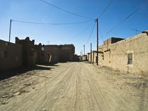 Typical architecture in Merzouga. Streetscape in Merzouga -Morocco with its typical buildings out of loam next to the desert Erg Chubby Royalty Free Stock Images