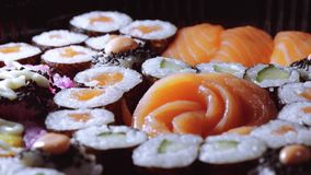 Typical Asian food - Variety of different Sushi pieces on big plate. Food photography stock footage
