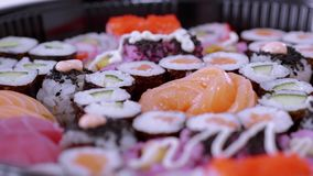 Typical asian food - variety of different sushi pieces on big plate. Food photography stock video