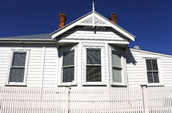 Typical Auckland New Zealand villa against blue sky Royalty Free Stock Photo
