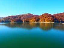 Autumn colours in Romania. Typical autumn colours at Paltinu lake, Doftana River Valley, Prahova County, Romania Royalty Free Stock Photography