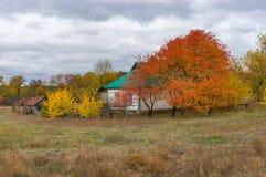 Landscape with small farmstead in Dem`yanivka village, Poltavskaya oblast, Ukraine. Typical autumnal landscape with small farmstead in Dem`yanivka village royalty free stock images
