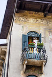 Typical balcony with antique green window in Verona. Typical vintage  building with antique windows and flowers in Verona ,Italy Royalty Free Stock Photos