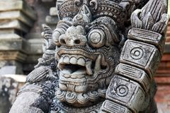 Typical Bali architecture. Sculpture of Barong. Royalty Free Stock Photo