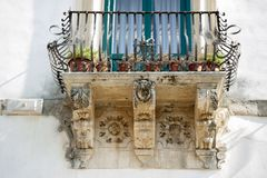Scicli, balcony. Typical baroque style balcony, in the city of sicily scicli royalty free stock photos