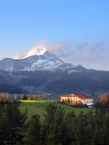 Typical basque country house surrounding by mountains. Typical basque country house in Aramaio valley surrounding by mountains Royalty Free Stock Photos
