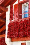 Pepper Frontage. A typical basque frontage with bunches of drying red pappers Royalty Free Stock Photo