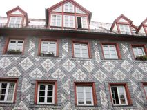 Typical Bavarian house, Furth, Germany. Typical Bavarian fachwerk house with tile decoration in old town of Furth, Germany, details of the exterior royalty free stock photography