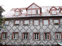 Typical Bavarian house, Furth, Germany. Typical Bavarian fachwerk house with tile decoration in old town of Furth, Germany, close view Royalty Free Stock Image
