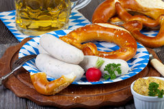 Typical Bavarian veal sausage snack on paper plate Royalty Free Stock Images