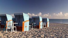 Typical beach chairs in Binz. Morning on the beach in Binz, Ruegen Island, Germany stock video footage