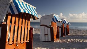 Typical beach chairs. Morning on the beach in Binz, Ruegen Island, Germany stock video footage