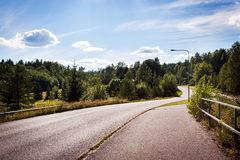 Typical beautiful road in the countryside of Finland Stock Photo