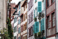 Typical beautiful street with colorful timbers and blinds for tourism Royalty Free Stock Image
