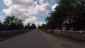 A typical Belarusian village in the summer. Travel through the countryside in the summer stock footage