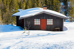 Typical black Norwegian cabin in the winter Royalty Free Stock Image