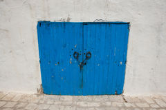 Typical blue local door, Tunis, Tunisia Royalty Free Stock Photo