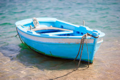 Typical blue and white color Greek fishing boat in Mykonos port in Greece Royalty Free Stock Photos