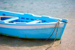 Typical blue and white color Greek fishing boat in Mykonos port on island of Mykonos, Cyclades, Greece Stock Photos