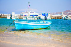 Typical blue and white color Greek fishing boat in Mykonos port on island of Mykonos, Cyclades, Greece Stock Image