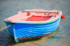 Typical blue and white color Greek fishing boat in Mykonos port on island of Mykonos, Cyclades, Greece Stock Photo